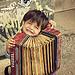 kid playing accordion