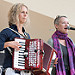 Mary Jane Lemond and Wendy MacIssac singing and playing the accordion on stage for the National Folk Life Festival, Greensboro, North Carolina.