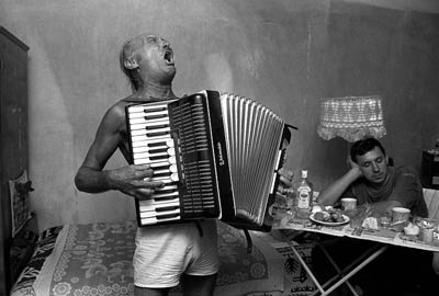 Man in underwear playing accordion